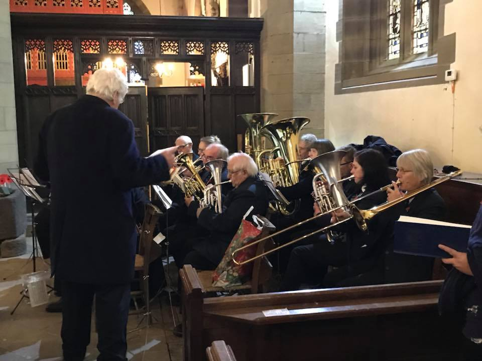 the band are playing inside the church