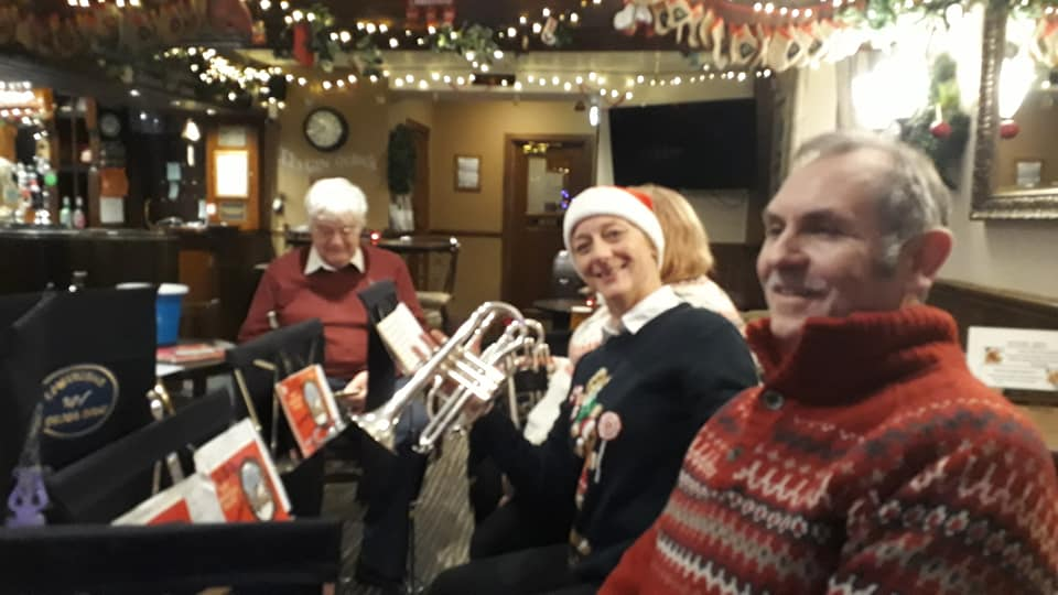 Band members smiling during carolling sessions