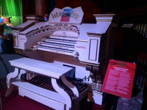 A large, white Wurlitzer organ