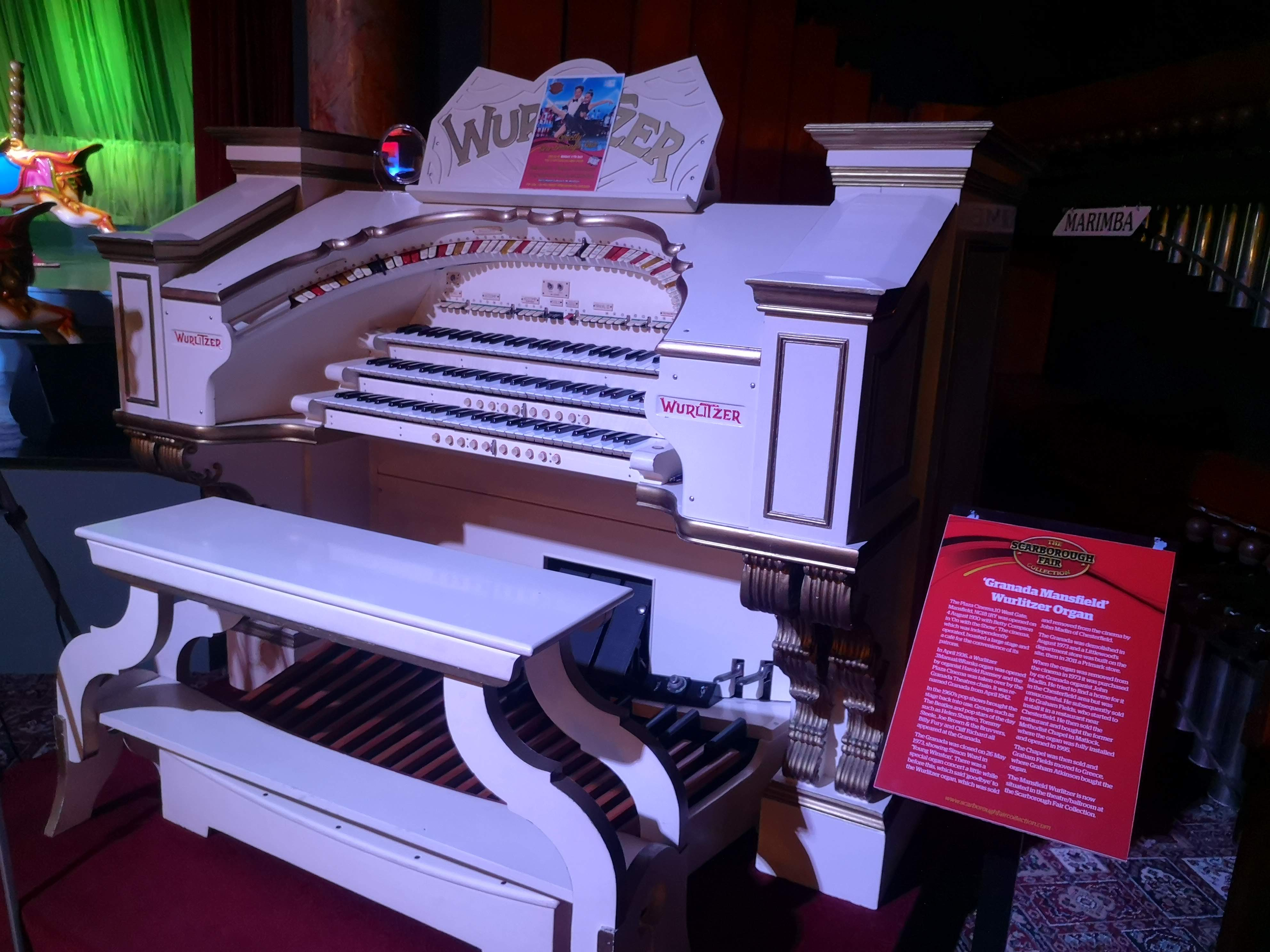 A large, white Wurlitzer organ