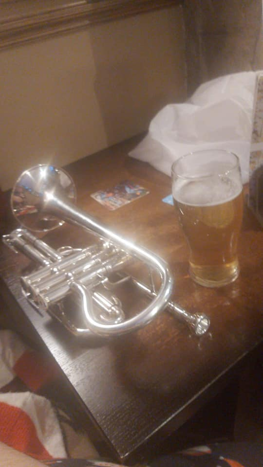 a cornet sits next to a pint of beer