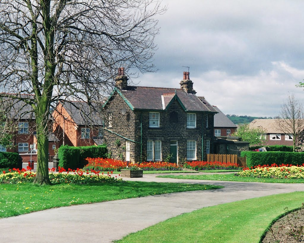 The Lodge at Stanningley Park, with a tree to the left and a path in the foreground.