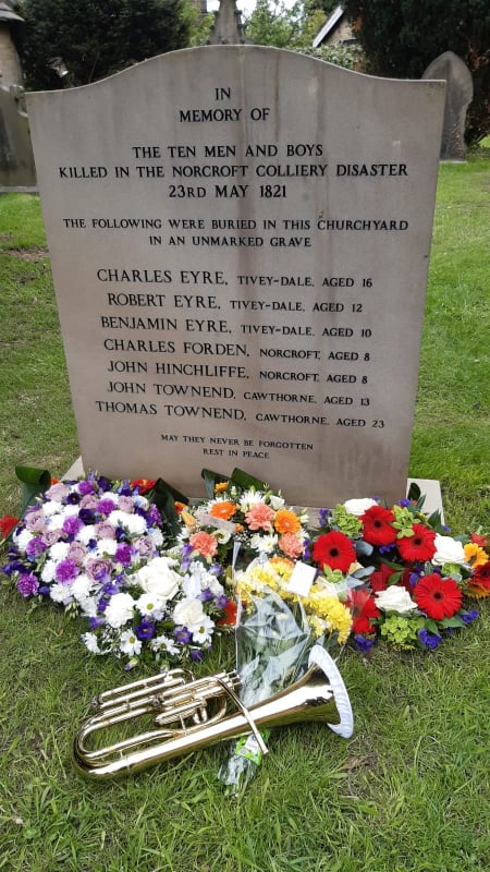 There is a Tenor Horn laid in front of the memorial stone in memory of the ten men and boys killed in the Norcroft Colliery Disaster 23rd May 1821.
